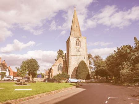 arden: TANWORTH IN ARDEN, UK - SEPTEMBER 25, 2015: The Village Green with St Mary Magdalene church vintage