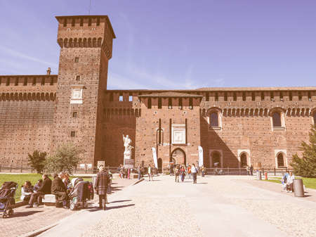 sforzesco: MILAN, ITALY - MARCH 28, 2015: People visiting the Sforza Castle aka Castello Sforzesco which is the oldest castle in town vintage Editorial