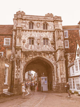 queueing: CANTERBURY, UK - SEPTEMBER 11, 2012: Tourists queueing under the Saint Augustine Gate in order to visit Canterbury Cathedral vintage