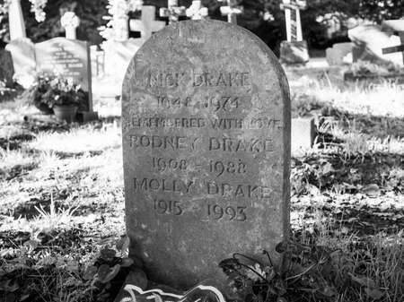 st nick: TANWORTH IN ARDEN, UK - SEPTEMBER 25, 2015: Grave of English musician Nick Drake in the churchyard of St Mary Magdalene church in black and white Editorial