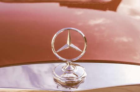 daimler: BERLIN, GERMANY - OCTOBER 25: Illustrative editorial of Mercedes Benz Daimler AG symbol on a car vintage