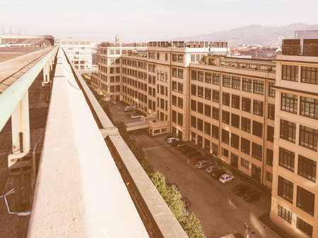 converted: TURIN, ITALY - DECEMBER 16, 2015: Fiat Chrysler Italian headquarters at former Lingotto car factory designed by Trucco in 1916 now converted to a business and exhibition centre by architect Renzo Piano vintage