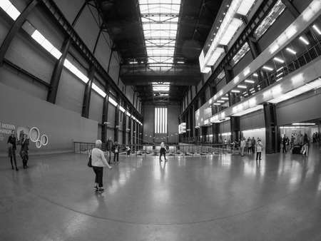 south space: LONDON, UK - SEPTEMBER 28, 2015: The Turbine Hall once housed the electricity generators of the power station now a public space part of Tate Modern art gallery in South Bank seen with fisheye lens in black and white Editorial
