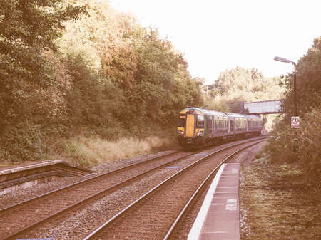 arden: TANWORTH IN ARDEN, UK - SEPTEMBER 26, 2015: London Midland train at Wood End railway station on the Stratford upon Avon to Birmingham route known at the Shakespeare Line vintage
