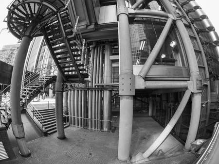 richard: LONDON, UK - SEPTEMBER 29, 2015: Lloyd of London is an iconic high tech skyscraper designed by architect Richard Rogers seen with fisheye lens in black and white Editorial