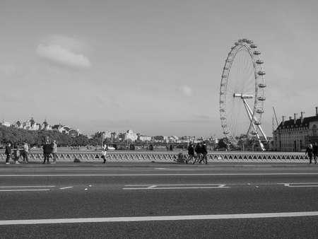 millennium wheel: LONDON, UK - SEPTEMBER 28, 2015: The London Eye ferris wheel on the South Bank of River Thames aka Millennium Wheel seen from Westminster Bridge in black and white