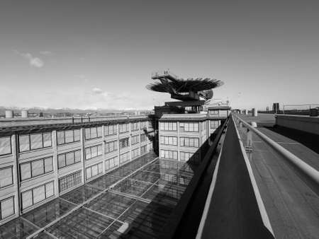 helipad: TURIN, ITALY - CIRCA MARCH 2016: Roof meeting room know as La Bolla meaning The Bubble and helipad at Lingotto conference centre designed by Renzo Piano in former Fiat car factory in black and white Editorial