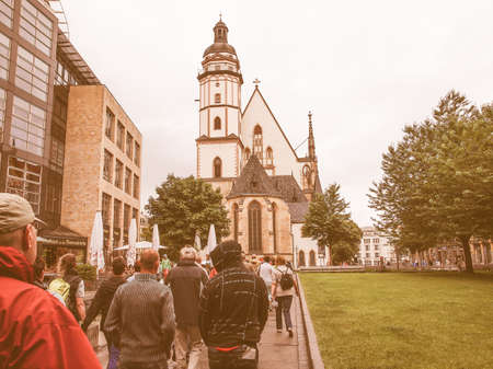 worked: LEIPZIG, GERMANY - JUNE 14, 2014: People visiting the Thomaskirche St Thomas Church where Johann Sebastian Bach worked as a Kapellmeister and the current location of his remains vintage