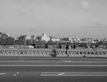 westminster bridge: LONDON, UK - SEPTEMBER 28, 2015: Westminster Bridge over River Thames in black and white