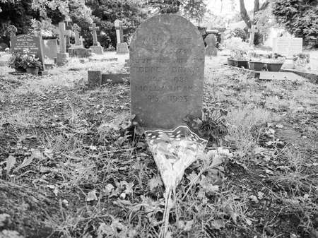 churchyard: TANWORTH IN ARDEN, UK - SEPTEMBER 25, 2015: Grave of English musician Nick Drake in the churchyard of St Mary Magdalene church in black and white Editorial