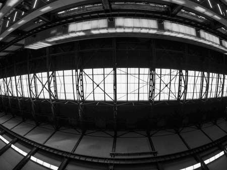 housed: LONDON, UK - SEPTEMBER 28, 2015: The Turbine Hall once housed the electricity generators of the power station now a public space part of Tate Modern art gallery in South Bank seen with fisheye lens in black and white Editorial
