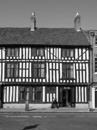 public house: STRATFORD UPON AVON, UK - SEPTEMBER 26, 2015: Oak bar public house in ancient Tudor building in black and white Editorial