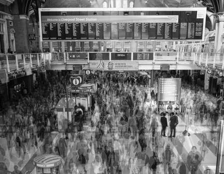 time lapse: LONDON, UK - SEPTEMBER 28, 2015: Travellers at Liverpool Street Station multi exposure time lapse in black and white