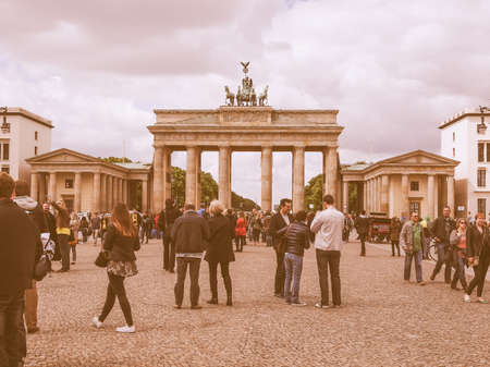 linking: BERLIN, GERMANY - MAY 10, 2014: Tourists visiting the Brandenburger Tor (Brandenburg Gate) linking East and West Berlin vintage Editorial