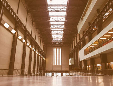 housed: LONDON, UK - CIRCA MARCH, 2009: The Turbine Hall which once housed the electricity generators of the power station is now a huge open public space part of Tate Modern art gallery in South Bank vintage