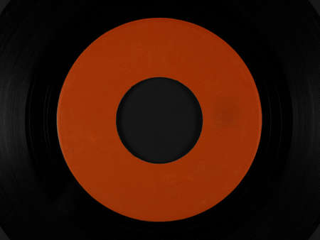 phonograph: Single 45 rpm vinyl on black rubber platter mat for a phonograph turntable, with blank orange label
