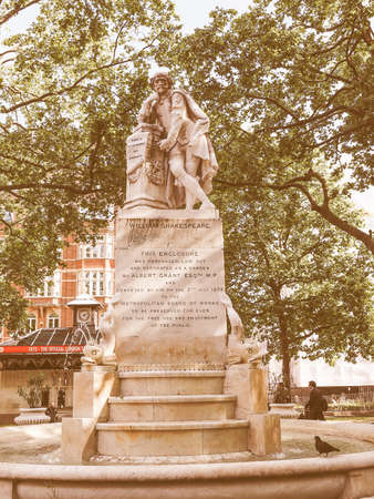 leicester: LONDON, UK - JUNE 10, 2015: Statue of William Shakespeare built in 1874 in Leicester Square vintage Editorial