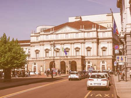 scala: MILAN, ITALY - APRIL 10, 2014: Tourists in front of  Teatro Alla Scala aka La Scala world famous opera house vintage Editorial