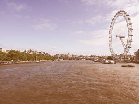aeronautical: LONDON, UK - JUNE 10, 2015: The London Eye ferris wheel on the South Bank of River Thames aka Millennium Wheel built in 1999 using advanced aeronautical engineering know how by British Airways vintage