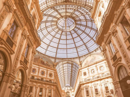 recently: MILAN, ITALY - MARCH 28, 2015: The Galleria Vittorio Emanuele II has been recently restored for the Expo Milano 2015 international exhibition vintage Editorial