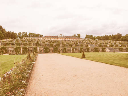 frederick: POTSDAM, GERMANY - MAY 10, 2014: Tourists visiting the baroque Schloss Sanssouci former summer palace of Frederick the Great King of Prussia vintage