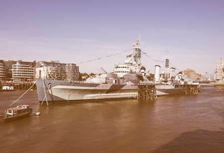 hms: LONDON, UK - JUNE 11, 2015: HMS Belfast ship originally a Royal Navy light cruiser is now permanently moored on the River Thames as a museum ship vintage Editorial