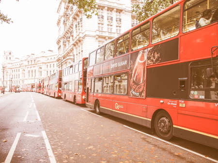 to depart: LONDON, ENGLAND, UK - OCTOBER 23: Row of double decker red buses waiting to depart from on October 23, 2013 in London, England, UK vintage