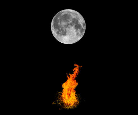 bonfires: Full moon and bonfires burning bright in the night - dark black background with copy space Stock Photo