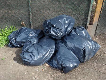 refuse: Black garbage bag aka trash bag or refuse bag Stock Photo