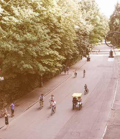 rikscha: TURIN, ITALY - JULY 11, 2015: Tourists on a rickshaw in Parco del Valentino park vintage