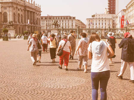 during: TURIN, ITALY - JUNE 19, 2015: People visiting the city centre during the Holy Shroud exhibition vintage