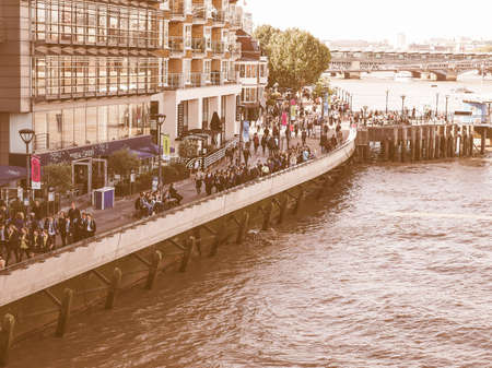 southbank: LONDON, UK - SEPTEMBER 29, 2015: Tourists walking on the River Thames South Bank vintage Editorial