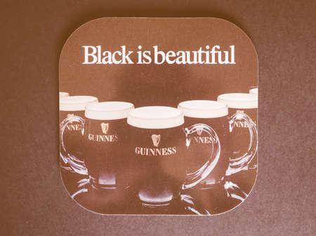bier: DUBLIN, IRELAND - DECEMBER 11, 2014: Beermat of Irish beer Guinness vintage Editorial