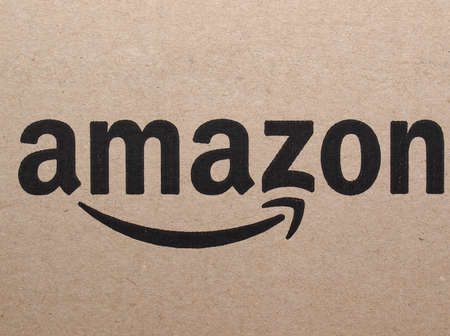 retailer: SEATTLE, USA - CIRCA APRIL 2016: Logo of online retailer Amazon on a corrugated cardboard packet used for worldwide shipping