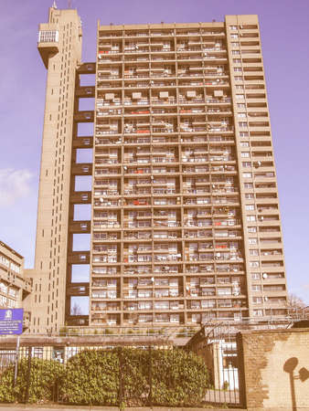 listed: LONDON, ENGLAND, UK - MARCH 05, 2009: The Trellick Tower in North Kensington designed by Erno Goldfinger in 1964 is a Grade II listed masterpiece of new brutalist architecture vintage