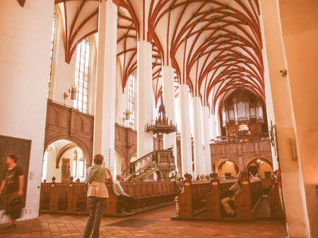 worked: LEIPZIG, GERMANY - JUNE 12, 2014: People visiting the Thomaskirche St Thomas Church where Johann Sebastian Bach worked as a Kapellmeister and the current location of his remains vintage