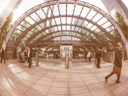 tube station: LONDON, UK - SEPTEMBER 29, 2015: The Canary Wharf tube station serves the largest business district in the United Kingdom vintage