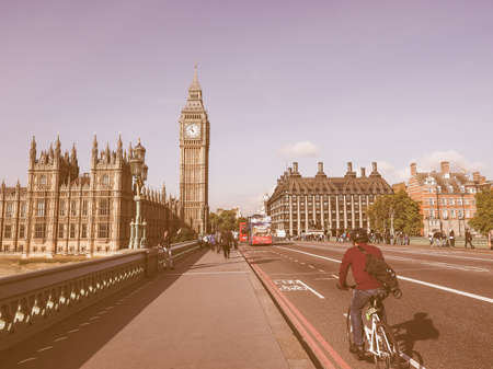 westminster bridge: LONDON, UK - SEPTEMBER 28, 2015: Tourists on Westminster Bridge at the Houses of Parliament aka Westminster Palace vintage