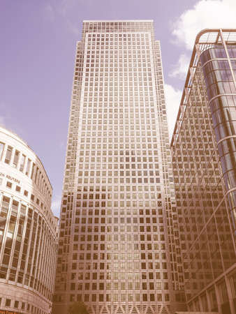 largest: LONDON, UK - JUNE 10, 2015: The Canary Wharf business centre is the largest business district in the United Kingdom vintage