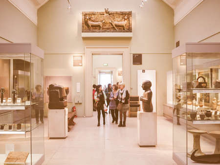 british museum: LONDON, UK - SEPTEMBER 28, 2015: Tourists visiting the British Museum vintage