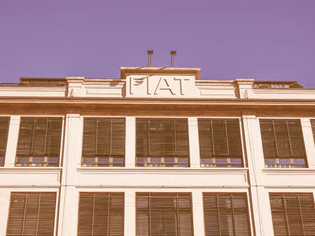exhibition complex: TURIN, ITALY - JANUARY 24, 2014: The Fiat Lingotto car factory designed by Trucco in 1916 was the largest car factory at the time and still houses the Fiat directional centre and an exhibition complex vintage