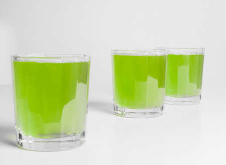 continental breakfast: Glasses of green apple juice on continental breakfast table Stock Photo