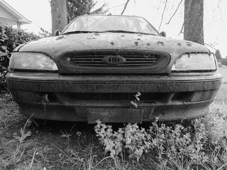 unused: An old unused abandoned vehicle aka dumped car in black and white