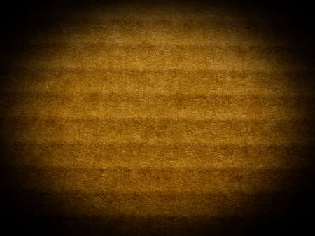 vignetted: Brown corrugated cardboard useful as a background - spotlight vignetted Stock Photo
