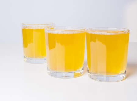 pineapple juice: Glasses of pineapple juice on continental breakfast table