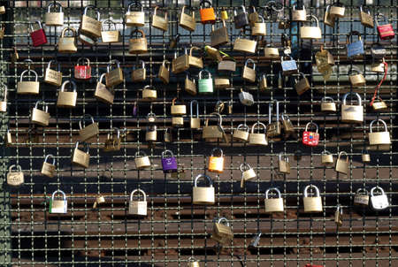guard rail: KOELN, GERMANY - CIRCA AUGUST 2009: Love locks on a bridge guard rail