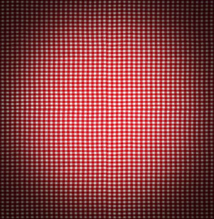 vignetted: Seamless tileable texture useful as a background - red checkered tablecloth fabric vignetted