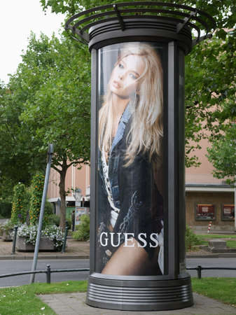 guess: DUESSELDORF, GERMANY - CIRCA AUGUST 2009: Guess street advertisement post