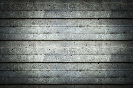 vignetted: Seamless tileable texture useful as a background - grey concrete wall vignetted