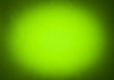 vignetted: Yellow green colour paper useful as a background vignetted Stock Photo